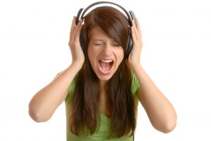 Girl listening to the music and screaming
